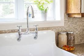 kitchen sink with backsplash rustic white porcelain kitchen sink with curved faucet and tile