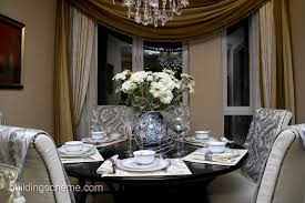 dining rooms crystal chandelier round wooden table brown stained