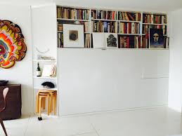 Bookcase Storage Units Transforming Wall Bed Bookshelf Storage Unit Improvised Life