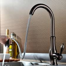 brass gooseneck kitchen faucet with pull out spray centerset two