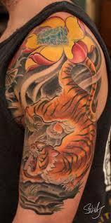 by marvin silva tattoos nature tiger tiger lotus