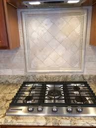 tumbled travertine backsplash close inset over cooktop tumbled travertine backsplash close inset over cooktop subway tile with square