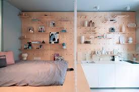 peg board this studio apartment has a beautiful peg board storage wall