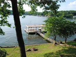 One Story Home by Sunset Cottage One Story Home Sloping Lot And Spacious Lake Views