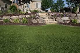 Slope Landscaping Ideas For Backyards Landscaping With Boulders On A Stop Slop With A Budget Slope