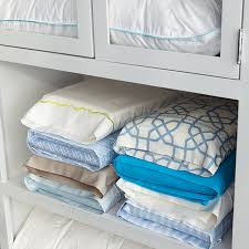 Folding Bed Sheets How To Keep Matching Sheets Together In The Closet Martha Stewart