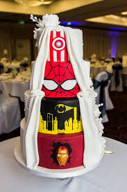 the wedding cake that cosplays as batman spider man iron man and