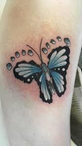 butterfly tattoo with baby footprint idea for grandchildren s footprints tatoos pinterest
