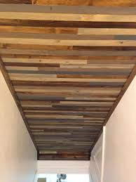 ceiling above basement stairs used wood lath strips to create a
