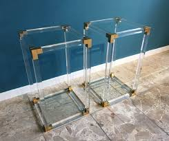 pair of midcentury side tables in lucite acrylic and brass