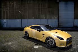 nissan gtr side view matte gold nissan gtr d2forged cv8 wheels three quarter front