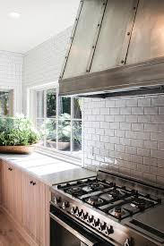 white subway tiles with black grout cottage kitchen
