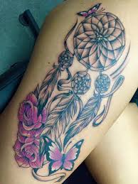 purple flowers and dreamcatcher tattoo on side leg