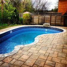 garden tile pool decks and pool landscaping with wood fences also