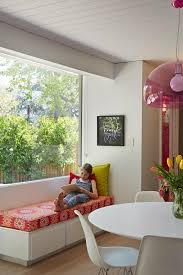 window bench ideas dining room midcentury with pink pendant
