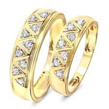 wedding bands sets his and hers 1 3 carat t w diamond his and hers wedding band set 10k yellow gold