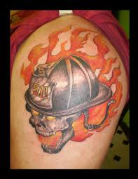 skull in firefighter s helmet and flames colored forearm