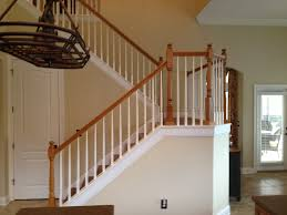 elite construction of jax inc interior trim contractor before picture of wood handrail