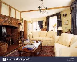 cream sofas and wooden coffee table in traditional cottage