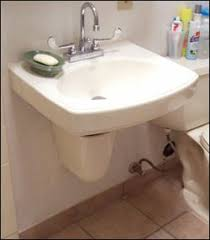 wall hung accessible sink with ceramic p trap cover accessible