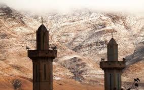 rare snowfall in the sahara creates a desert winter wonderland