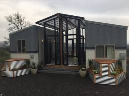 two home two 24 tiny houses connected by sunroom