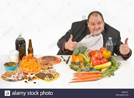 table full of food overweight man sitting at a table full of food stock photo 78072032
