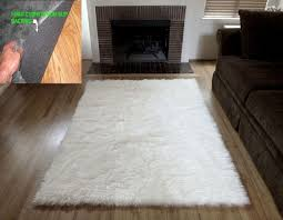decor white fur rug with white leather sofa and chair for living