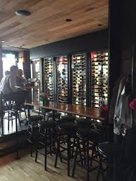 custom wine cabinet at pod 51 and salvation burger building wine