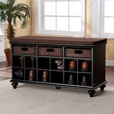black wooden shoe storage bench with dark brown fabric seat and