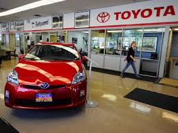 toyota showroom toyota to recall 6 5 million cars to fix power window switch