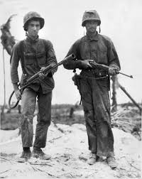 Marines Holding Flag Two U S Marines On Peleliu 1944 The Marine On Left Is Armed