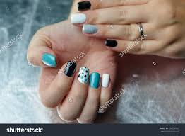 female hand trendy manicure nail design stock photo 534252502