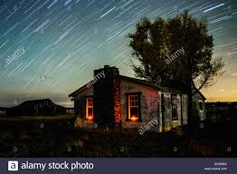 star trails over a ranch house stock photo royalty free image