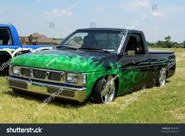 nissan green lowrider nissan truck green flames stock photo 9445495 shutterstock