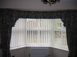 interior design glass window with bali blinds and floral curtains