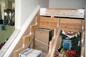 Stair Trim Molding by Remodelaholic Filling The Gaps Stair Remodel