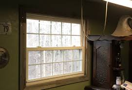 new window trim from reclaimed wood for my garage bar album on