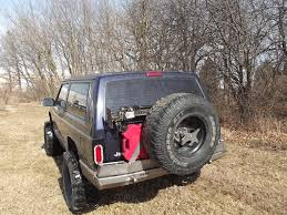 cherokee jeep xj xj rear evolution expedition tire carrier add on ares fabrication