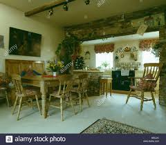pine settle and dining table and chairs in country kitchen with