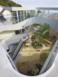 elevated house with an underneath garden architecture