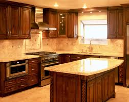 dark brown wooden kitchen cabinet with cream granite countertops