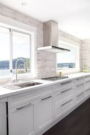 contemporary white kitchen linear mosaic backsplash