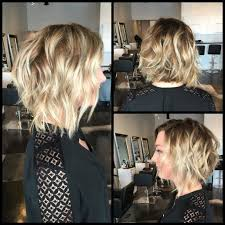 medium lentgh hair with highlights and low lights women s wavy platinum lob with blunt ends and highlights and