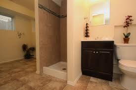 peach wall bathroom laundry room combination with black cabinet on