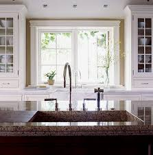 Traditional Home Great Kitchens - love the idea of the cabinets flanking the window and resting on