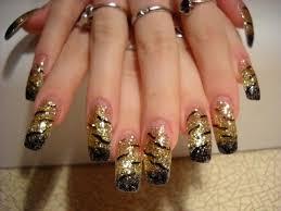 fingern gel design vorlagen nägel fotos schwarz gold bei anya kazan nageldesign