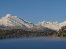 mountain backdrop fog on auke lake with mountain backdrop by chesteronriver photo