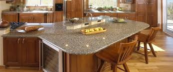 brown wooden kitchen cabinet using gray granite countertop plus