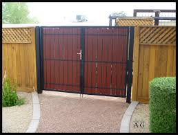 classic barn wooden driveway gates with chevron panels also cement